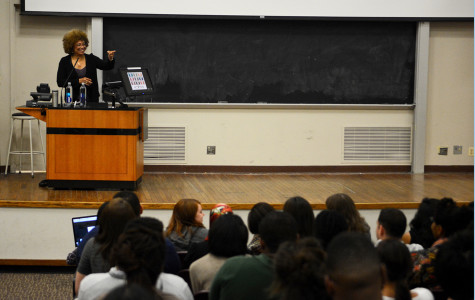 Angela Davis interacts with audience members during her talk at Fisk Hall Monday night. Davis discussed a variety of topics during the presentation, including her work in the anti-prison movement.
