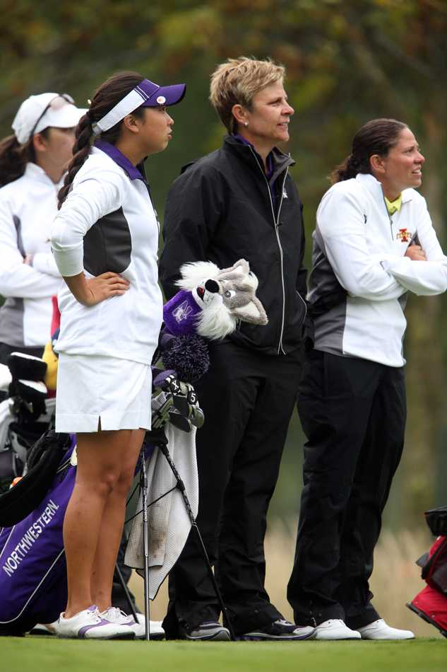 Emily Fletcher observes the action. Fletcher is in her sixth year as the women's golf head coach and has led her team to national prominence.