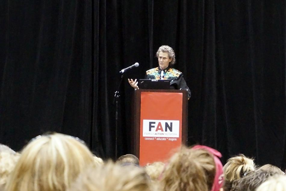 Temple Grandin speaks during her lecture at Welsh-Ryan Arena Wednesday night. Grandin highlighted the importance of encouraging different thinking styles, particularly with autistic children.
