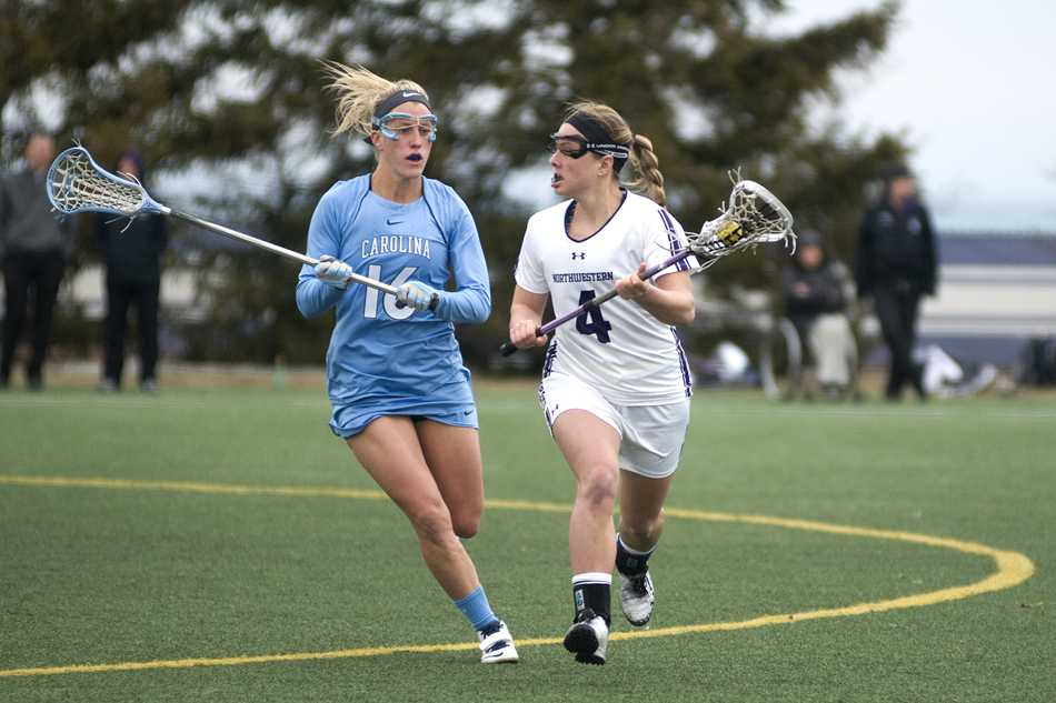 Senior+attack+Kat+DeRonda+looks+upfield.+DeRonda+scored+three+goals%2C+including+the+game-winner+in+overtime%2C+helping+Northwestern+beat+Florida+12-11+in+the+NCAA+quarterfinals+to+advance+to+the+Wildcats%27+10th+straight+Final+Four.
