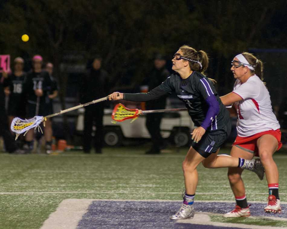 Draw control specialist Alyssa Leonard reaches for the ball after a draw. The senior's performance in the circle improved drastically in the second half, collecting 10 draws compared to 3 draws in the first.