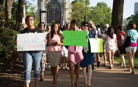 """Members of Alpha Kappa Alpha organized a march Wednesday for sexual assault awareness. Many participants, including some male students, wore heels during the event, """"Walk a Mile in Her Shoes."""""""