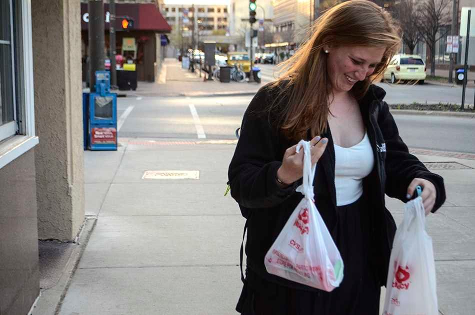 Weinberg freshman Jessica Hoffman uses plastic bags after a trip to the drug store. Some Evanston aldermen say they would support a plastic bag ban in Evanston.