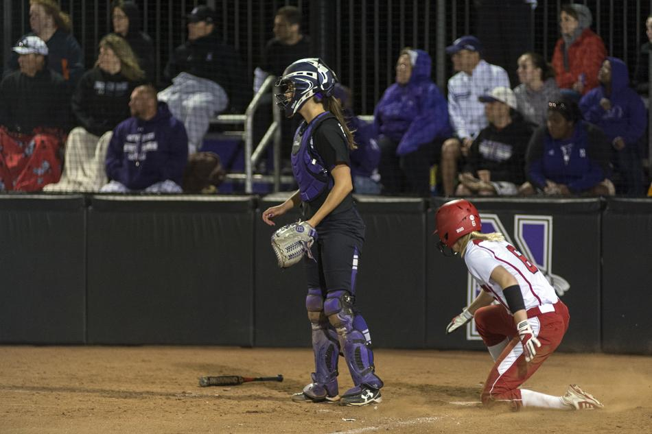 Wisconsin infielder Katie Christner slides home with a third-inning run in the Big Ten Tournament on Friday night. The Badgers defeated Northwestern 5-4, advancing to the next round and leaving the Wildcats to prepare for the NCAA Tournament.