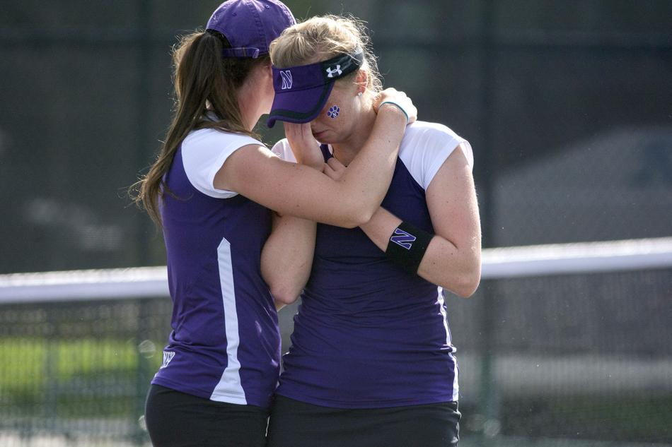 Sophomore Alicia Barnett and freshman Jillian Rooney console each other after Northwestern's heartbreaking loss in the second round of the NCAA Tournament. The Wildcats fell to Notre Dame 4-3, ending their season.