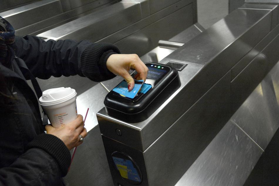 A passenger uses her Ventra card to pay for a ride on the CTA. CTA and PACE completed their transition to Ventra Tuesday.