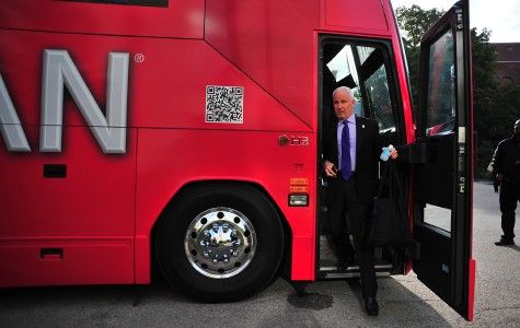 University president Morton Schapiro leaves the CSPAN bus Wednesday morning. Schapiro's interview touched on NU's historically high tuition and historically low admission rate, as well as the school's relationship with the rest of the Big Ten conference.
