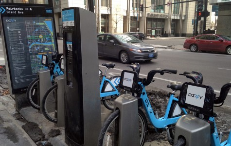 Divvy bikes sit at a rental station in the city of Chicago. The bike sharing service will come to Evanston in spring 2015.