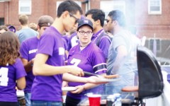 Students congregate by the grill at Fitzerland, the student tailgate area, before the 2013 football game against Maine.
