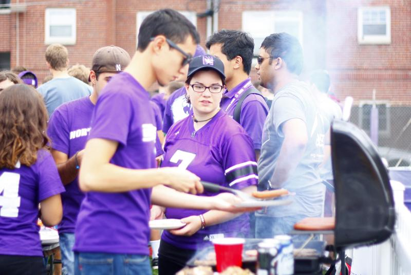 Students+congregate+by+the+grill+at+Fitzerland%2C+the+student+tailgate+area%2C+before+the+2013+football+game+against+Maine.