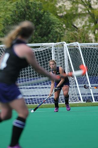 Junior Charlotte Martin slaps a pass upfield during Northwestern's 5-1 win over Ball State on Saturday. Martin had an assist Sunday in the No. 15 Wildcats' 3-2 upset over No. 2 Maryland and added three more assists against Ball State.