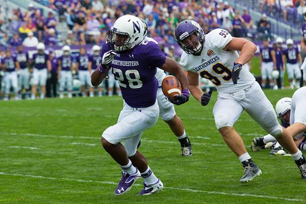 Running back Justin Jackson scampers past a Western Illinois defender. The true freshman bore the brunt of the rushing workload, toting the ball 21 times for 92 yards.