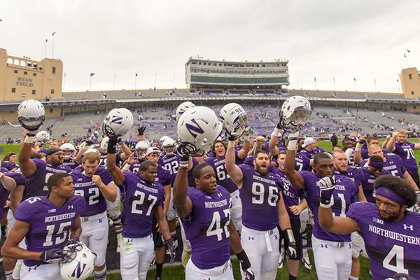 Northwestern players face fans and celebrate after the team's 24-7 victory over Western Illinois. The win provided some relief for the Wildcats, who had lost their first two games before Saturday.