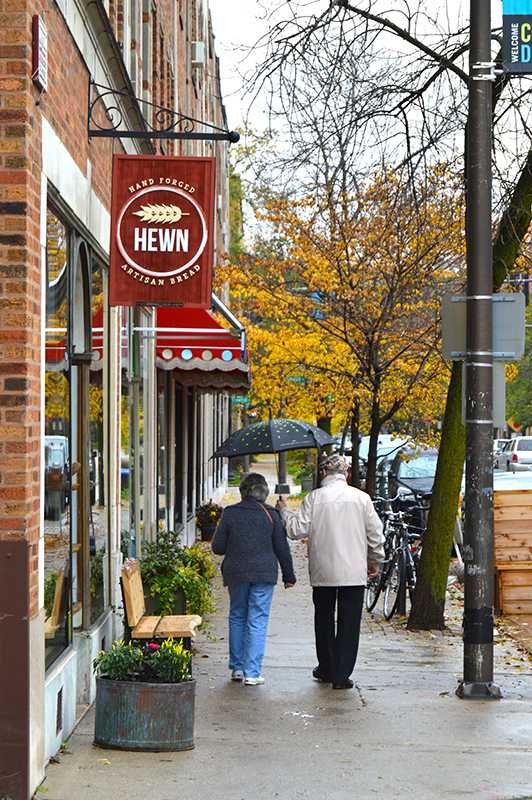 People+walk+by+Hewn%2C+located+at+810+Dempster+St.+The+bakery+is+one+of+two+Evanston+businesses+that+are+finalists+for+the+2014+Martha+Stewart+American+Made+Awards%2C+which+recognizes+places+that+produce+local%2C+homemade+goods.