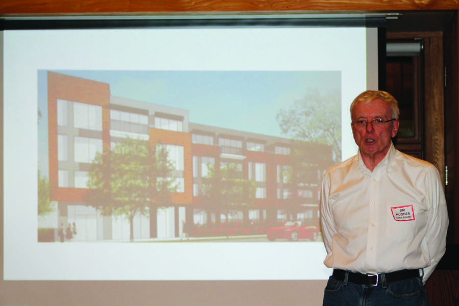 Jim Hughes, vice president of Central Street Neighbors Association, describes the proposal for a project on Central Street. The CSNA held a meeting Thursday night to educate residents on regulations of the street's infrastructure.