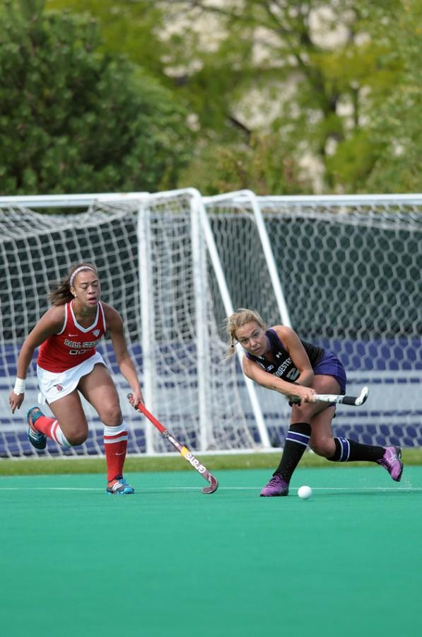 Junior midfielder Kelsey Gradwohl passes the ball away from a defender in a game last month. No. 9 Northwestern will face No. 14 Michigan and No. 22 Michigan State this weekend.