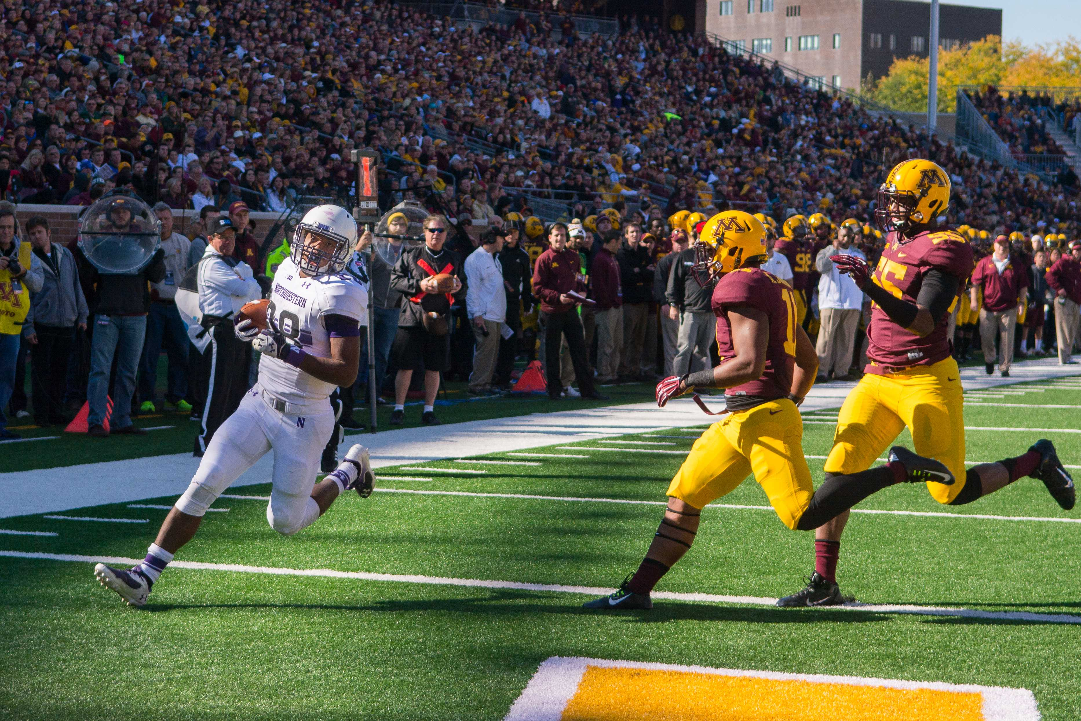 Freshman running back Justin Jackson glides into the end zone after an 11-yard catch-and-run for Northwestern's only touchdown of the first half. Jackson gained 67 yards on the ground during the first half, and senior quarterback Trevor Siemian completed 10 of his 14 pass attempts.