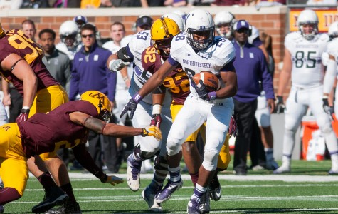 Freshman running back Justin Jackson eludes Minnesota defenders on one of his 23 carries Saturday. Despite Northwestern's loss, Jackson was named Big Ten Freshman of the Week, becoming the third straight Wildcats player to win the award.