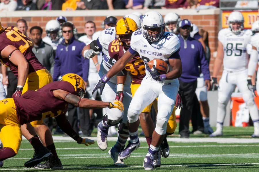 Freshman+running+back+Justin+Jackson+eludes+Minnesota+defenders+on+one+of+his+23+carries+Saturday.+Despite+Northwestern%E2%80%99s+loss%2C+Jackson+was+named+Big+Ten+Freshman+of+the+Week%2C+becoming+the+third+straight+Wildcats+player+to+win+the+award.