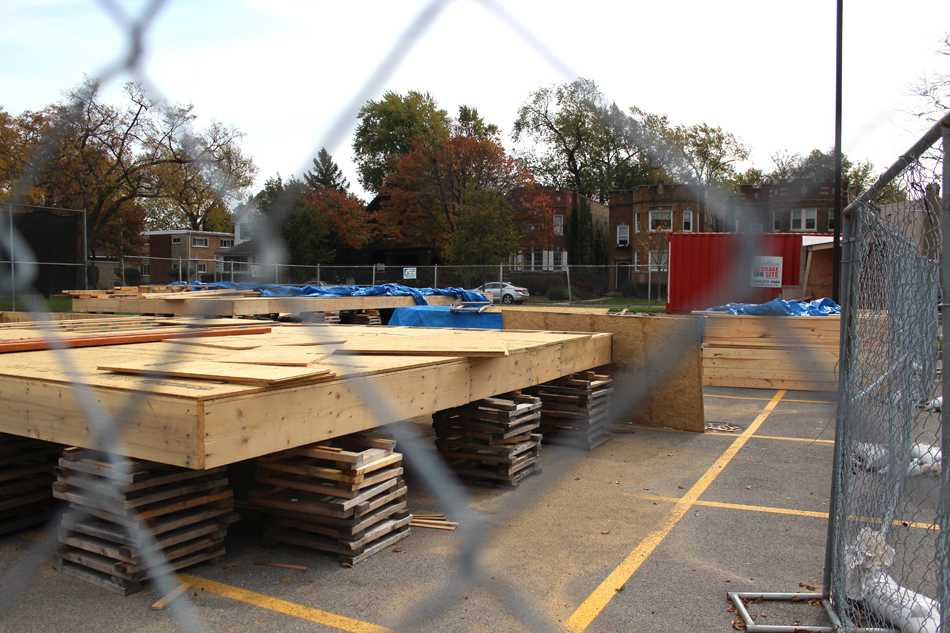 Evanston Township High School students have started to construct a two-story house in the school's parking lot. The project is part of a class in which students learn geometry through hands-on experience and build affordable housing for a family with low income.