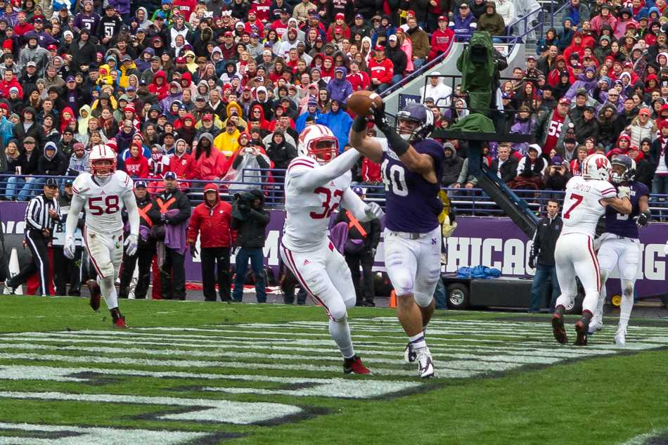 Junior superback Dan Vitale reigns in a Trevor Siemian pass for Northwestern's only touchdown of the first half.