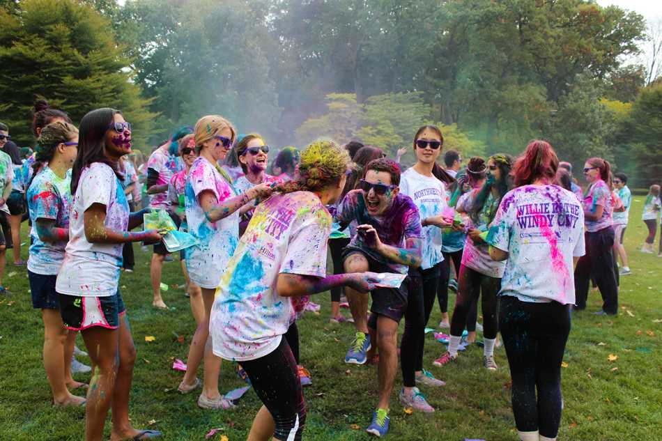 Students throw colored paint at each other at the third annual Color Roar on Deering Meadow. The event, which raised more than $1,500 for the Summer Internship Grant Program, was the first school-wide activity of Homecoming Week.