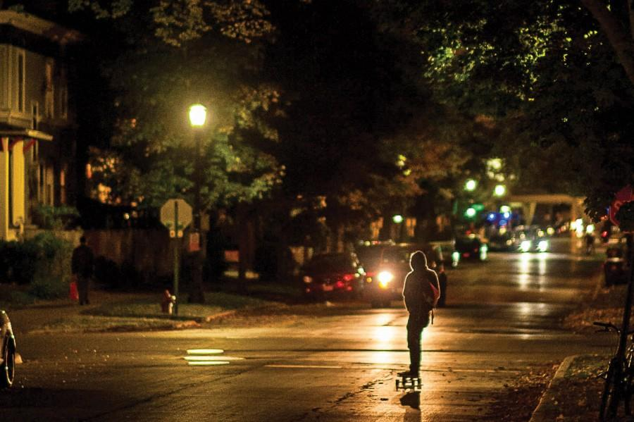 A person skateboards by a streetlight on Foster Street on Tuesday night. Lighting and safety is a consistent concern for students who live off campus, said Anthony Kirchmeier, director of off-campus life.