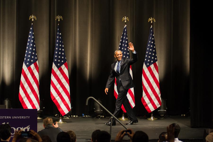 President Barack Obama greets a cheering crowd Thursday as he walks onto the stage in Cahn Auditorium. Obama gave a speech directed at Kellogg School of Management students, calling them the nations future business leaders.