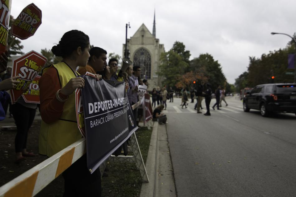 Students and community members line Sheridan Road in protest of Obama's policies on immigration, fiscal reform and international affairs. Many different groups congregated by The Arch, including M.E.Ch.A de Northwestern and Turning Point USA.