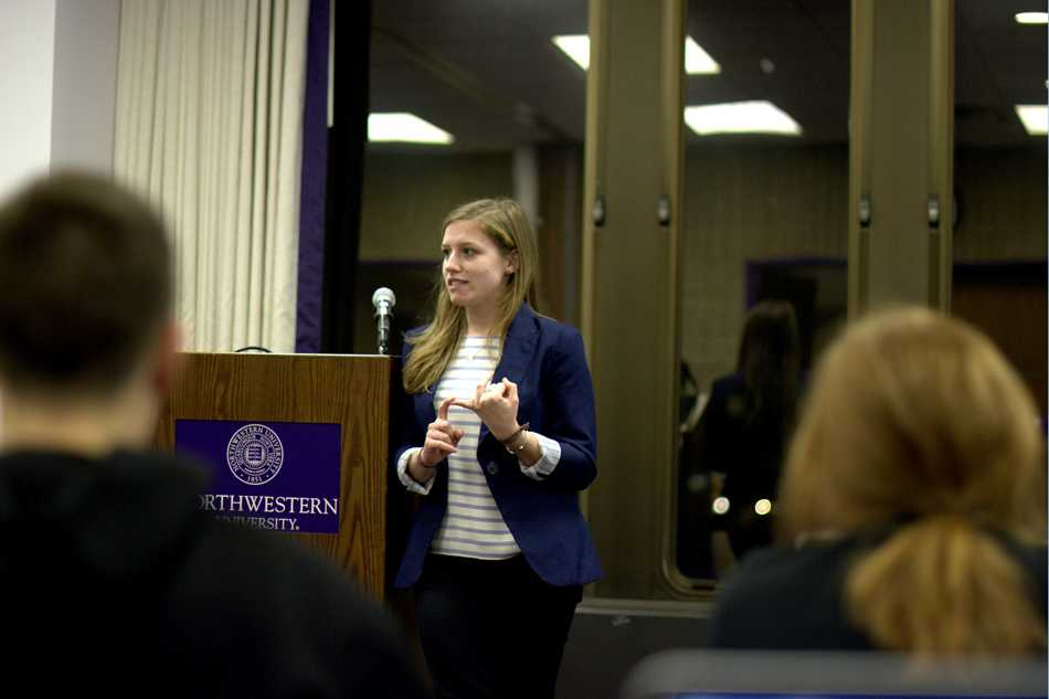 Northwestern Community Development Corps chair Taylor Billings discusses NCDC's efforts to connect student groups at Senate Wednesday. Billings said the organization also wants to reduce over-programming on campus.