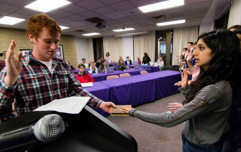 Speaker Noah Star swears in a new senator Wednesday at Associated Student Government's second meeting of the quarter. Senate passed legislation regarding the Wild Ideas Fund during the meeting.