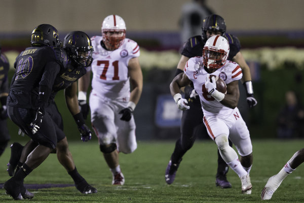 Nebraska running back Ameer Abdullah carries for several of his 107 second-half yards in Saturday's win over Northwestern. Abdullah and the Cornhuskers outscored the Wildcats 24-0 after halftime and outgained NU in yards 244-28.