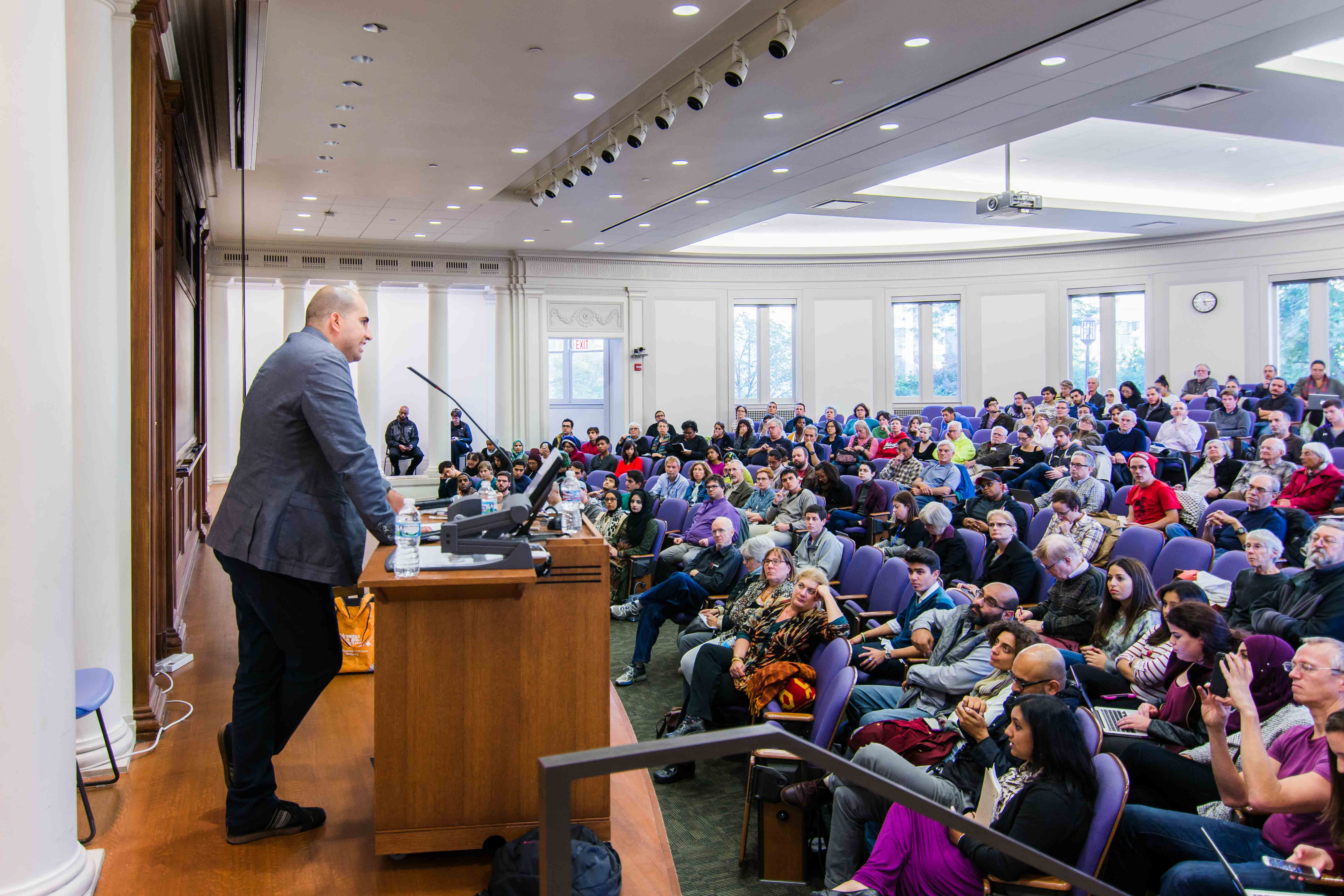Steven Salaita addresses a crowd of about 200 in Harris Hall. Salaita, a professor who was fired from the University of Illinois over controversial tweets regarding the conflict in the Gaza Strip, delivered a speech about academic freedom and his views on the events of the summer.