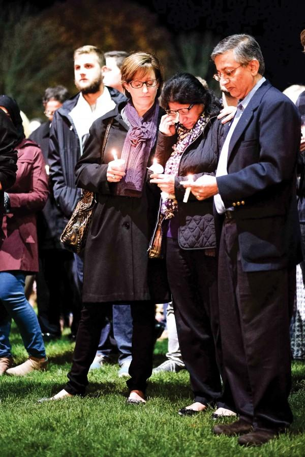 McCormick senior Mihirtej Boddupalli's parents, center and right, mourn as members of the Northwestern community tell stories about their son Tuesday night. Boddupalli died in a car accident in July at the age of 21.