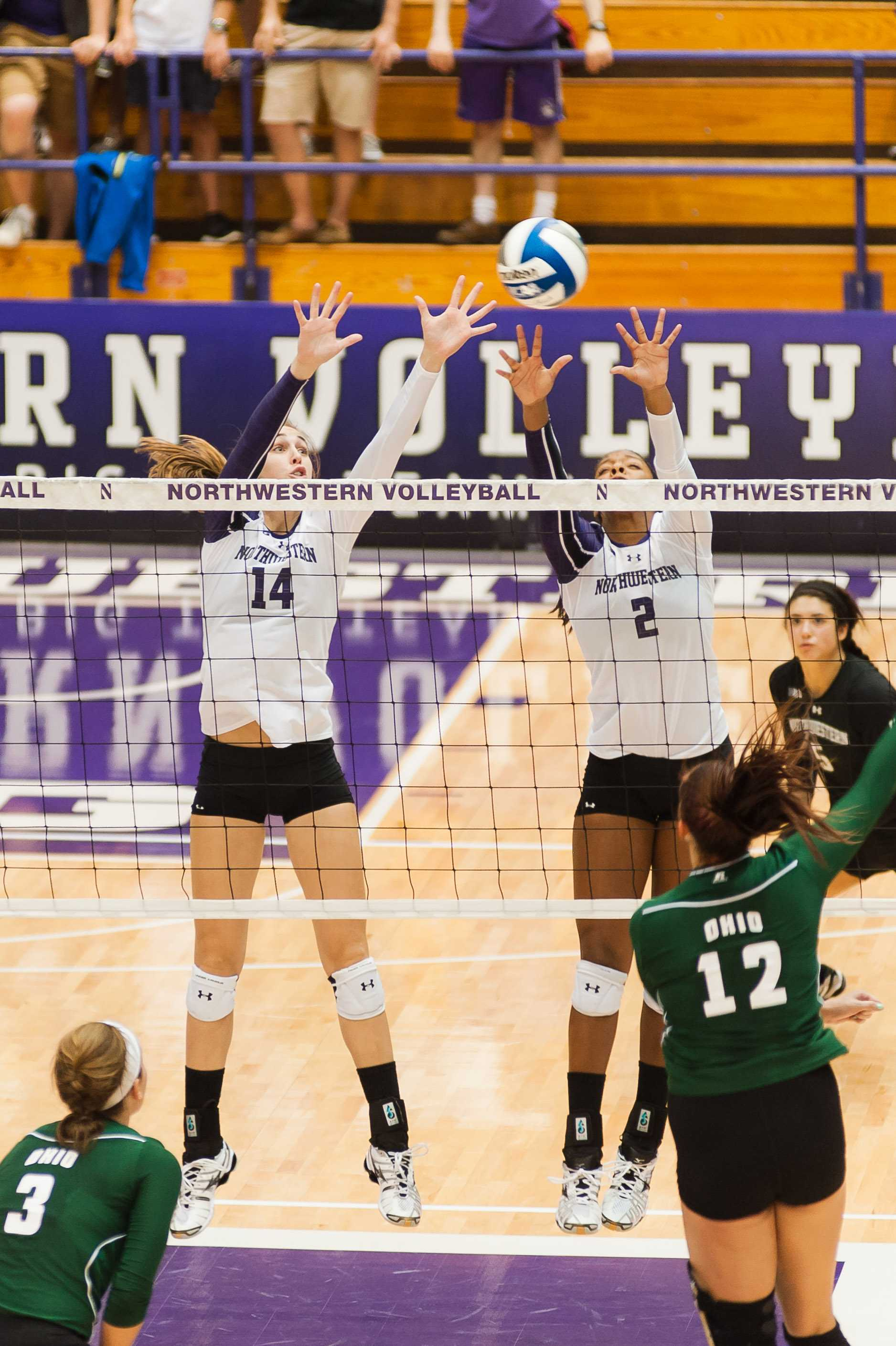 STANDING TALL Senior Katie Dutchman and freshman Symone Abbott go up a block. The pair combined for 22 kills against the Badgers, which was almost half of the Wildcats' 45.