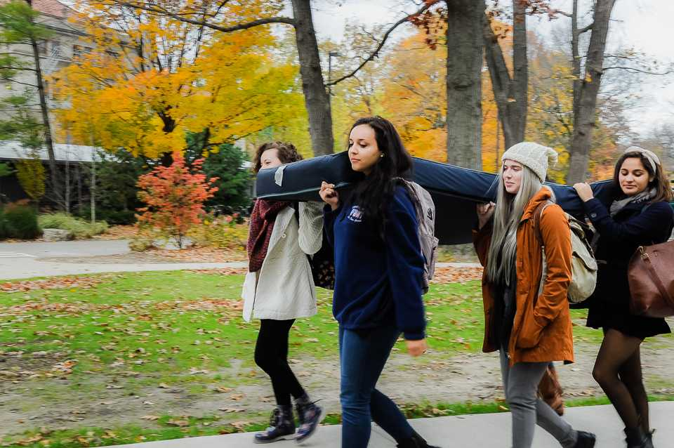 Communication freshmen Phoebe Fox, Kimberly McBride, Gaby Sant'Anna and Allison Towbes carry a mattress as part of the Carry That Weight Day of Action. Colleges across the country participated to show support for survivors of sexual assault.