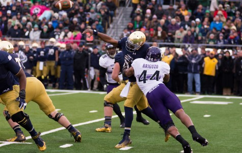 Senior linebacker Chi Chi Ariguzo hits Notre Dame quarterback Everett Golson. The team captain has elevated his play this season in the absence of fellow senior linebacker Collin Ellis.
