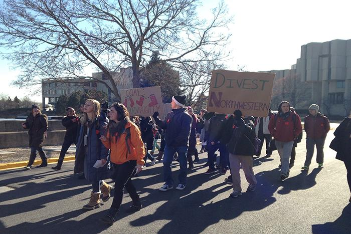 Students march from Norris University Center to the Allen Center, where a Board of Trustees meeting took place Friday. The demonstration was organized by DivestNU to ask Northwestern to divest its endowment funds from the coal industry.