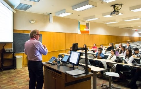 Dr. Robert Murphy, special adviser to the president's Emergency Plan for AIDS Relief in Nigeria, speaks Tuesday about the Ebola epidemic to an audience of about 25. Murphy discussed common misunderstandings surrounding the virus.