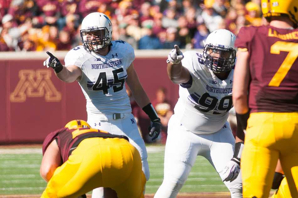 Senior linebacker Collin Ellis (45) played only four games this season as he battled multiple concussions. Coach Pat Fitzgerald announced Monday that Ellis will retire from football.