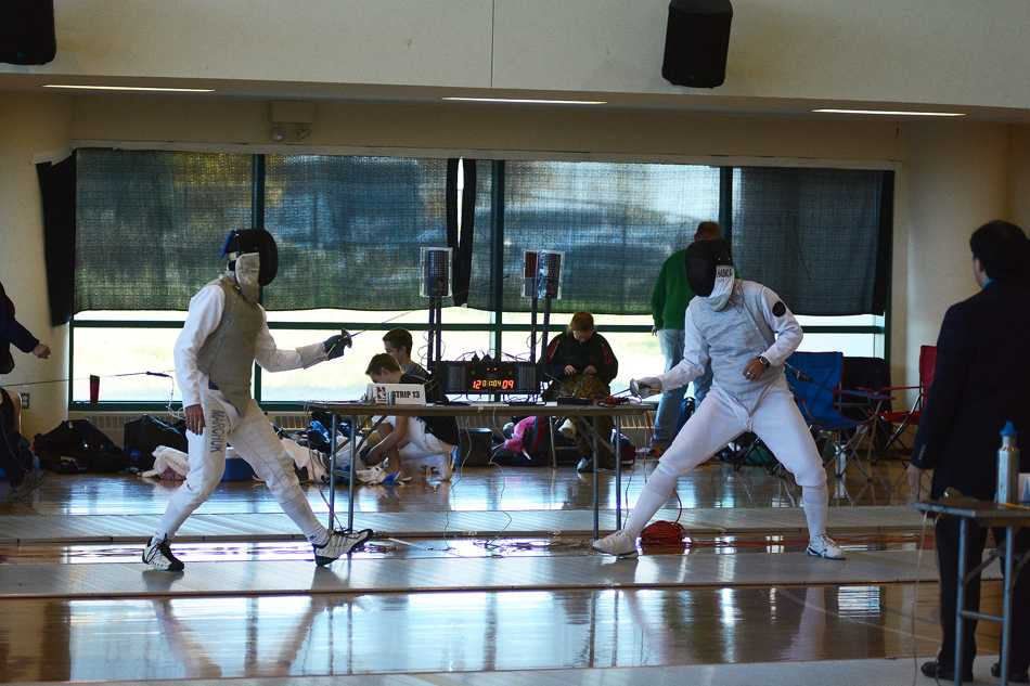 Two fencers square off in a dual meet earlier this season. The Wildcats struggled with an alternate scoring format this weekend, falling to the Fighting Irish 60-45.