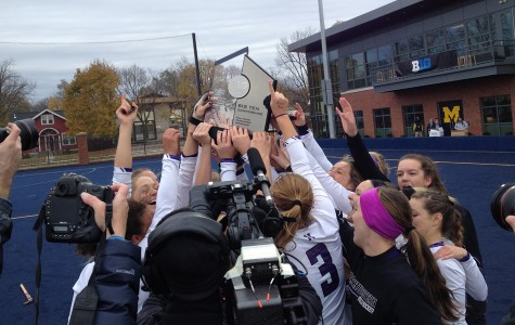 Northwestern players celebrate with their trophy after defeating Maryland to win the Big Ten Tournament. Sophomore Isabel Flens scored the go-ahead goal for Northwestern, and senior goalkeeper Maddy Carpenter was named tournament MVP.