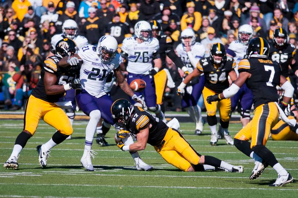 Kyle Prater fumbles the ball late in the first half. Prater's bobble, which led to an Iowa touchdown, was one of a slew of Northwestern miscues en route to a 38-7 halftime deficit and a 48-7 defeat at the hands of the Hawkeyes.