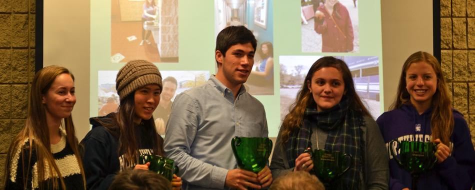 Winners of this year's Green Cup pose for photos with their trophies. Greek houses and residential buildings competed for points in the monthlong sustainability competition by saving energy and water, and attending events.