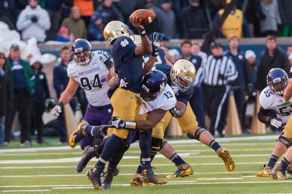 Junior defensive end Deonte Gibson pressures Notre Dame quarterback Everett Golson in the first half. Golson's pass was intercepted by Anthony Walker and returned to the Notre Dame 4-yard line, setting Northwestern up for an easy touchdown.