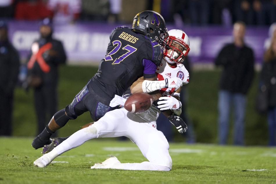 Sophomore cornerback Matthew Harris hits a Nebraska defender during Northwestern's Oct. 18 game. Harris and fellow-corner Nick VanHoose will face a new challenge this weekend against pass-happy Notre Dame.