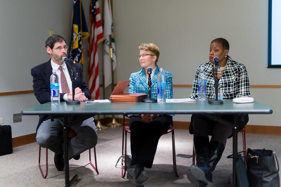 Panelist+Dr.+Avery+Hart%2C+from+the+Erie+Family+Health+Center%2C+speaks+to+a+group+of+around+20+people+Tuesday+at+the+Evanston+Public+Library.+The+three+health+officials+discussed+the+local+health+resources+available+to+the+community.