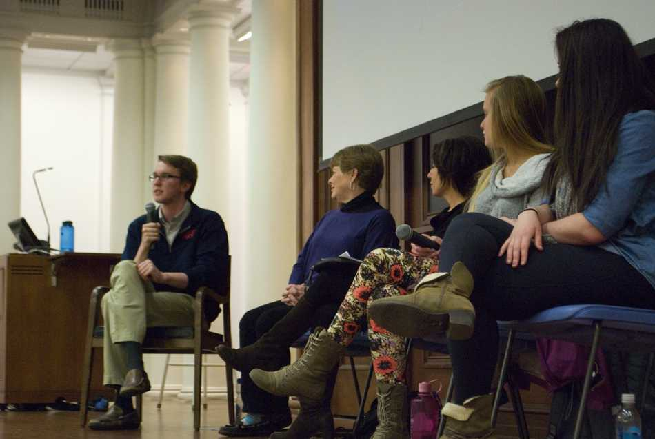 """Communication senior A.J. Roy, left, moderates a panel of Northwestern students, a professor and an administrator as they discuss socioeconomic inequality in college. The panel was hosted by NU's Quest Scholars and the upcoming Arts Alliance production of """"Good People."""""""