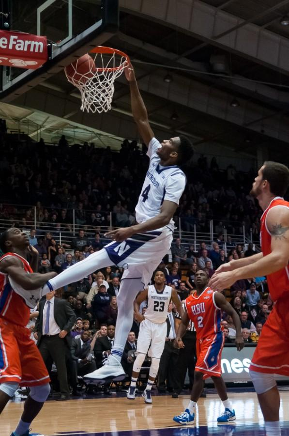 Freshman forward Vic Law throws down a one-handed dunk during the first half of Northwestern's 65-58 win over Houston Baptist on Friday. Law helped carry the Wildcats in the first half and finished with 13 points.
