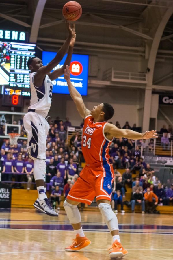 Freshman guard Scottie Lindsey fires a jump shot during Northwestern's game against Houston Baptist. Lindsey scored 10 points in 13 minutes against Brown, showing off the Wildcats' depth.